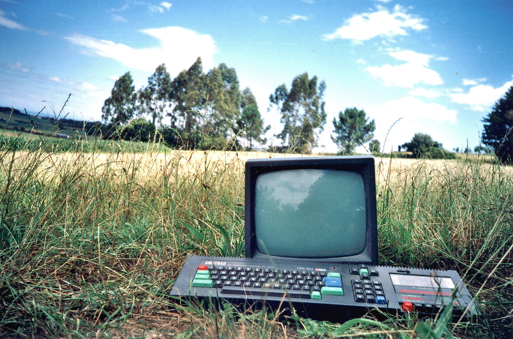 a wallpaper with an Amstrad CPC 464 in the nature