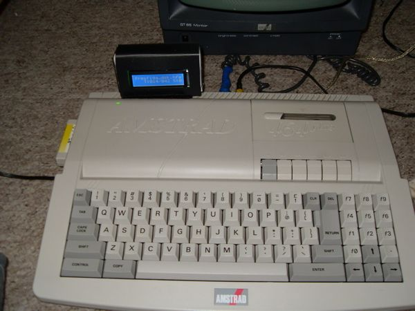 CPC 464+ modded with 128 Ko RAM and the HxC floppy emulator running